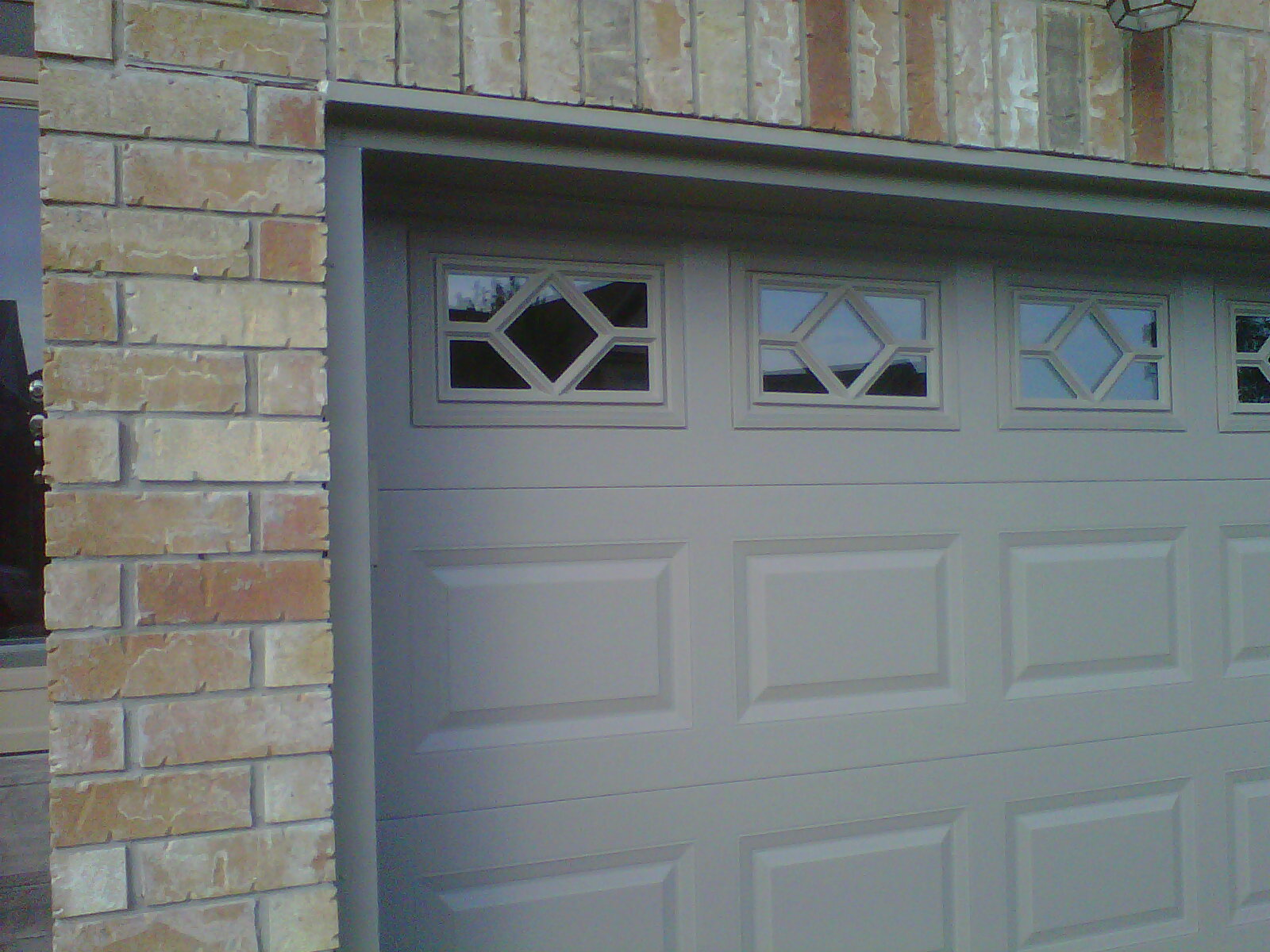 Garage doors gallery open door windows and doors inc for The door and the window